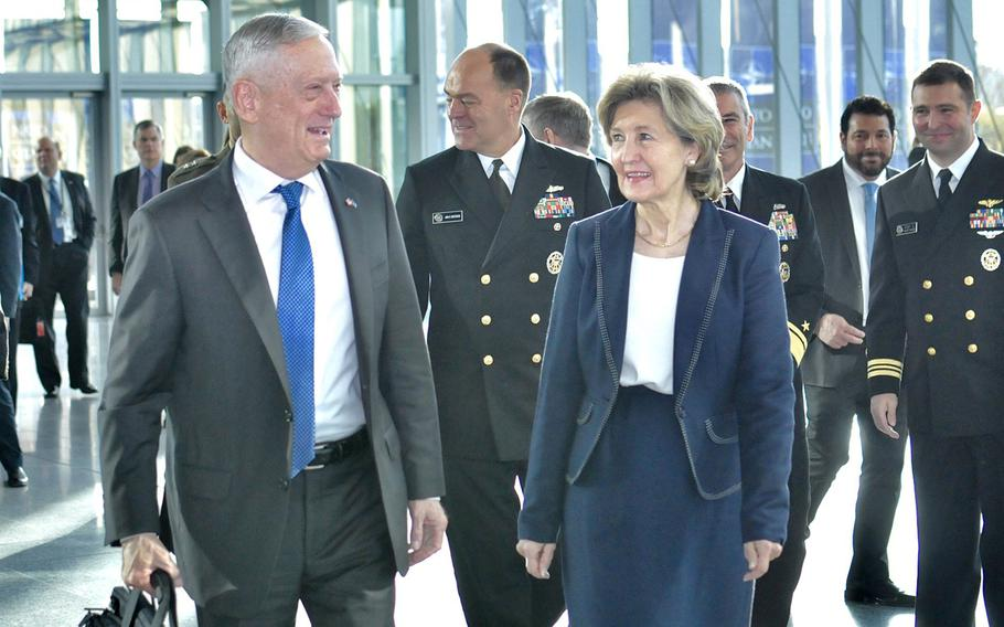 Defense Secretary Jim Mattis is met at  NATO Headquarters in Brussels, Belgium by Kay Bailey Hutchison, the American ambassador to NATO on his way to the the NATO defense ministers' meeting, Wednesday, Oct. 3, 2018.