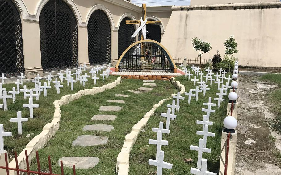 The rebuilt church at Balangiga is next to an outdoor ossuary where bones were recently unearthed that locals think might belong to American soldiers.