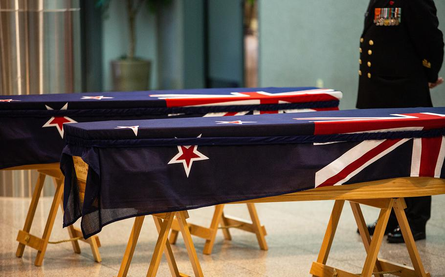 A pair of caskets belonging to New Zealand servicemembers who died after the Korean War are seen at Osan Air Base, South Korea, Friday, Oct. 5, 2018.