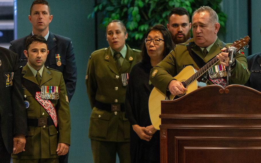 New Zealand servicesmembers sing a folk song during a repatriation ceremony at Osan Air Base, South Korea, Friday, Oct. 5, 2018.