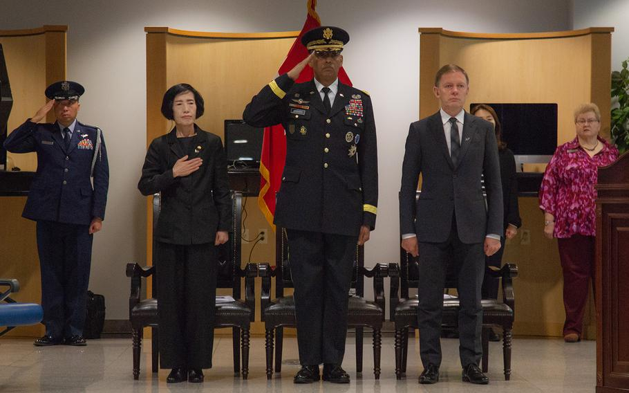 Foreground, from left: Pi Woo-jin, South Korean minister of Patriot and Veteran Affairs; Gen. Vincent Brooks, U.S. Forces Korea commander; and Philip Turner, New Zealand ambassador to South Korea, attend a repatriation ceremony at Osan Air Base, South Korea, Friday, Oct. 5, 2018. Marcus Fichtl/Stars and Stripes