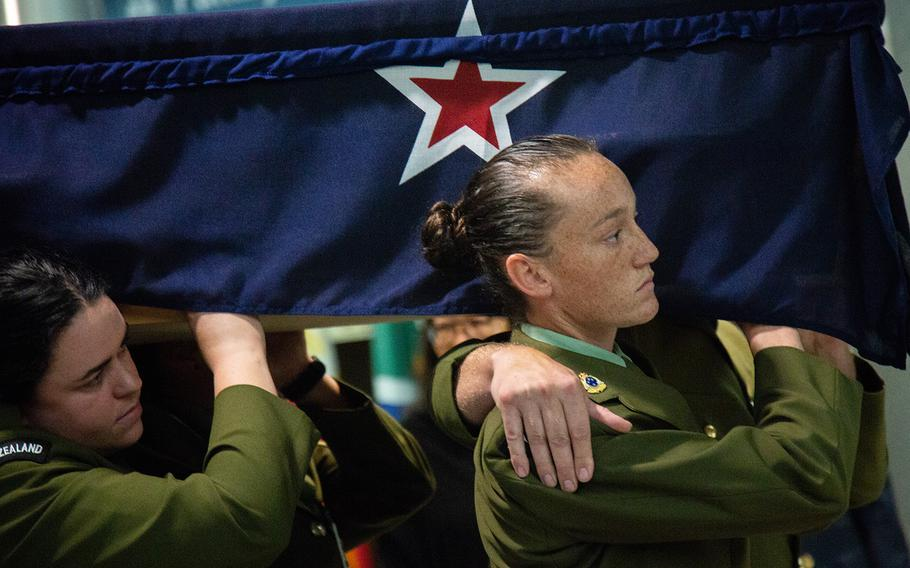 New Zealand soldiers carry the casket of Herbert Humm at Osan Air Base, South Korea, Friday, Oct. 5, 2018.