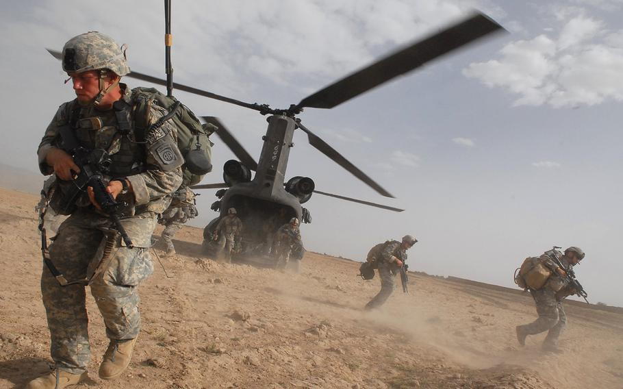 Soldiers hustle from the belly of a Chinook helicopter during a July 18, 2007, air assault in Afghanistan. Nearly half of Americans think the U.S. has failed to achieve its goals in what has become the longest war in the nation's history, according to a new Pew Research Center poll.