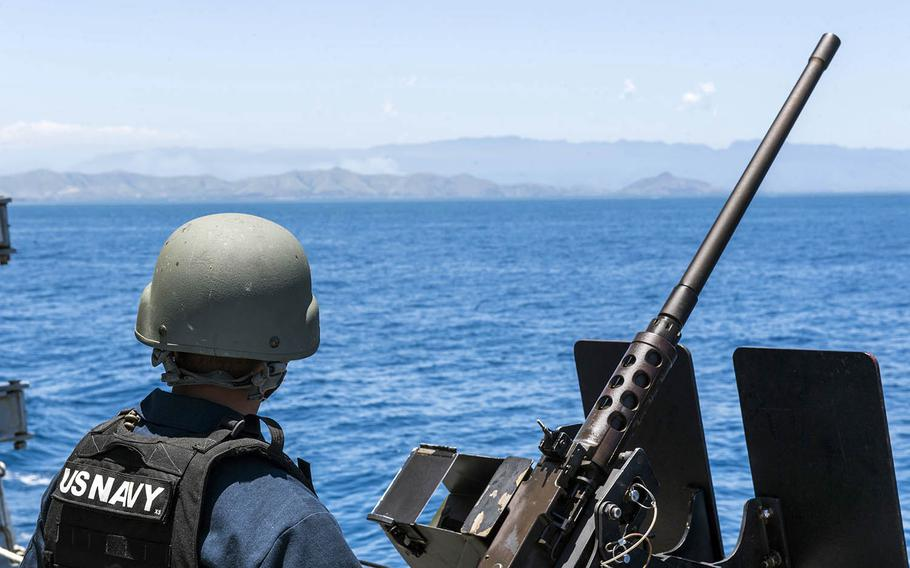 Petty Officer 2nd Class Christian Koch stands watch aboard the guided-missile destroyer USS Michael Murphy as it arrives in Papua New Guinea, Saturday, Oct. 6, 2018.