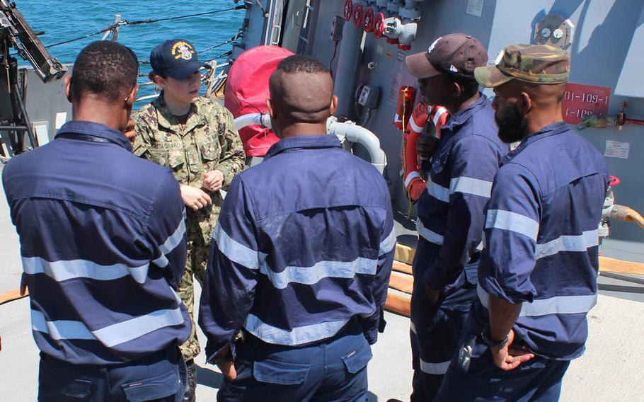 Ensign Cynthia Castagnaro speaks with members of the Papua New Guinea Defense Force aboard the USS Michael Murphy at Port Moresby, Papua New Guinea, Sunday, Oct. 7, 2018.