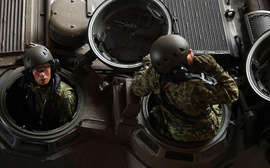 Japanese troops embark aboard the USS Ashland in an amphibious-assault vehicle during Kamandag drills in Subic Bay, Philippines, Oct. 3, 2018.