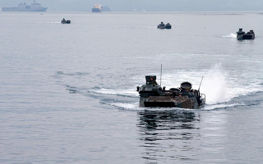 Japanese troops in amphibious-assault vehicles prepare to embark aboard the USS Ashland in assault amphibious vehicles during Kamandag drills in Subic Bay, Philippines, Oct. 3, 2018.