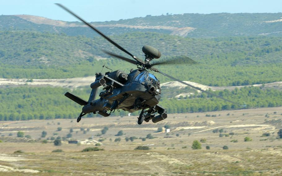 A U.S. Army AH-64 Apache helicopter flies over the San Gregorio training area near Zaragoza, Spain, during NATO's Trident Juncture 15 exercise in November 2015.