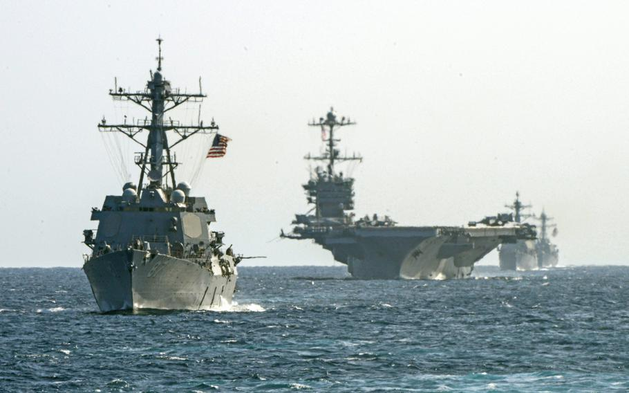 Ships from the USS Harry S. Truman Carrier Strike Group assume formation Aug. 30, 2018. The strike group and its 6,000 personnel will join NATO's largest military drill since 2002 later this month.