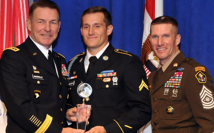 Cpl. Matthew Hagensick, center, the 2018 Soldier of the Year, poses with Army Vice Chief of Staff James McConville, left, and Sergeant Major of the Army Dan Dailey, right, on Oct. 8, 2018, at the Association of the United States Army annual meeting in Washington, D.C.