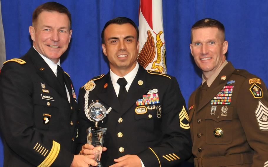 Sgt. 1st Class Sean Acosta, center, the U.S. Army's 2018 NCO of the Year poses with Army Vice Chief of Staff James McConville, left, and Sergeant Major of the Army Dan Dailey, right, on Oct. 8, 2018, at the Association of the United States Army annual meeting in Washington, D.C.