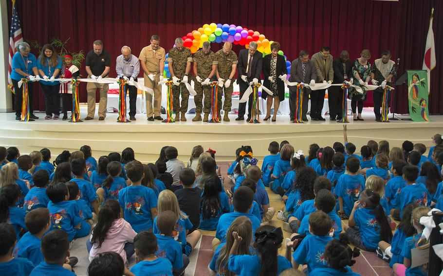 Leaders, faculty, students and architects of the new Zukeran Elementary cut the ribbon for the new school at Camp Foster, Okinawa, Wednesday, Oct. 10, 2018.