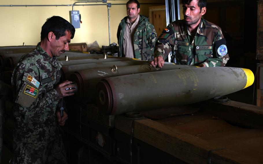 Afghan troops on March 6, 2018, assemble munitions to be used in airstrikes by the Afghan air force. The United Nations has expressed concern over a growing number of civilian casualties caused by airstrikes by both Afghan and international forces this year.