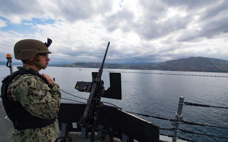 Petty Officer 1st Class Adam Foti stands watch aboard the destroyer USS Winston S. Churchill as the ship departs Souda Bay, Greece, Oct. 9, 2018.