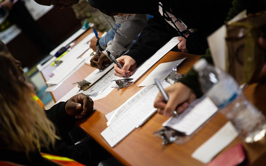 Soldiers fill out foms after being evacuated during an exercise at Yongsan Garrison in Seoul, South Korea, Thursday, Oct. 11, 2018.