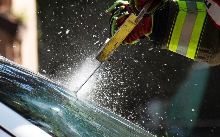 A firefighter saws through a car windshield during an exercise at Yongsan Garrison in Seoul, South Korea, Thursday, Oct. 11, 2018.