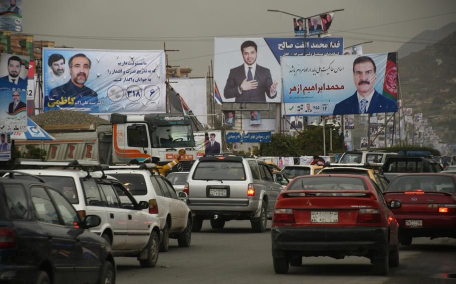Election posters line a Kabul street on Monday, Oct. 8, 2018. Afghanistan's parliamentary elections are set for Oct. 20, 2018.