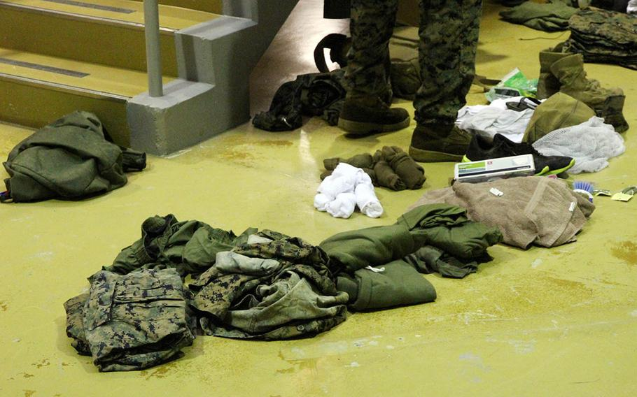 Marines empty the contents of their sea bags at the Camp Hansen brig as they arrive for the Correctional Custody Unit 2.0 program in August.