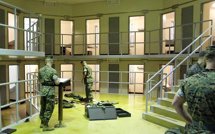 Marines pack their foot lockers at the Camp Hansen brig after arriving for the Correctional Custody Unit program in August.