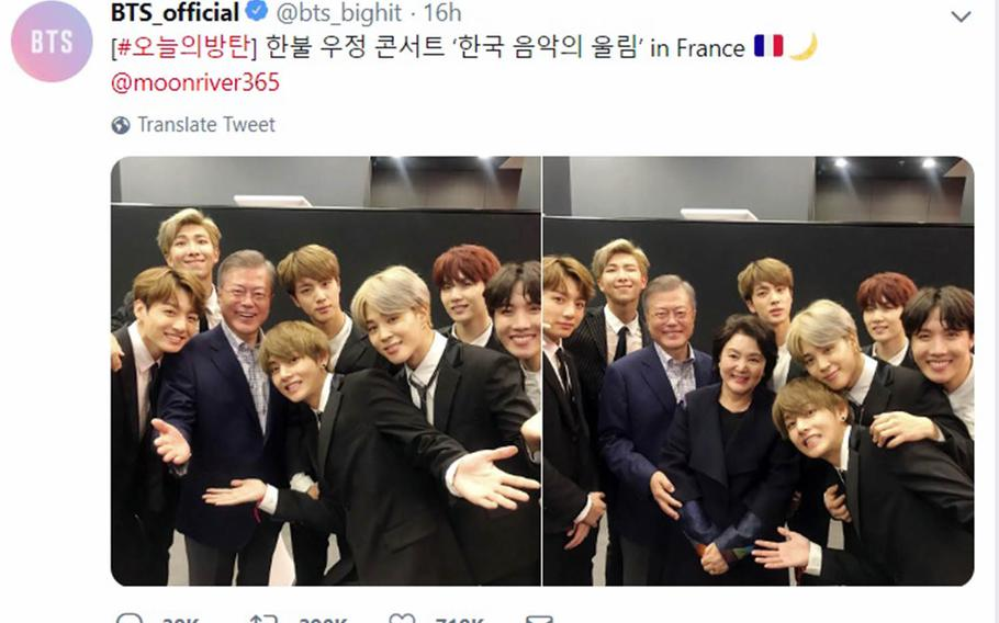 Members of the boy band BTS pose with South Korean President Moon Jae-in and his wife, Kim Jung-sook, in photos posted to the group's official Twitter account.