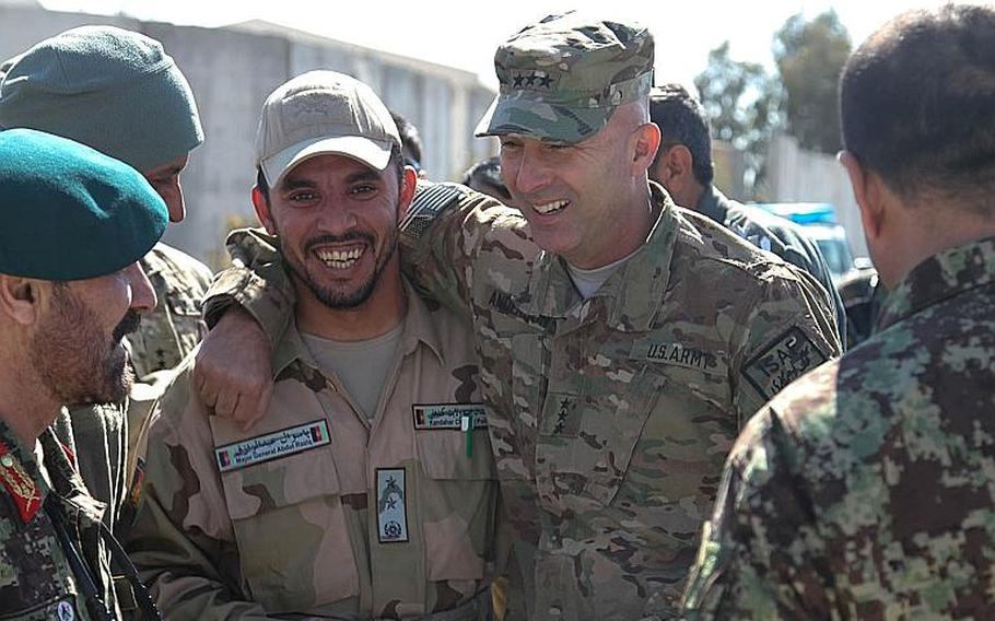 Then-Maj. Gen. Abdul Raziq, left, police chief of Kandahar province, meets Army Lt. Gen. Joseph Anderson, at the Joint Regional Afghan National Police Center in 2014. Raziq was shot and killed Oct. 18, 2018 at the Kandahar governor's residence, shortly after U.S. Gen. Scott Miller and other U.S. servicemembers were there. The Taliban claimed responsibility for the killing.