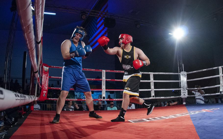 Sloan Grey, right, of Stuttgart follows through after landing a right hook against Brenden Chernis of Baumholder during their super heavyweight bout at the Oktoberfest Boxing Championships in Stuttgart.  Grey won the Saturday night fight.