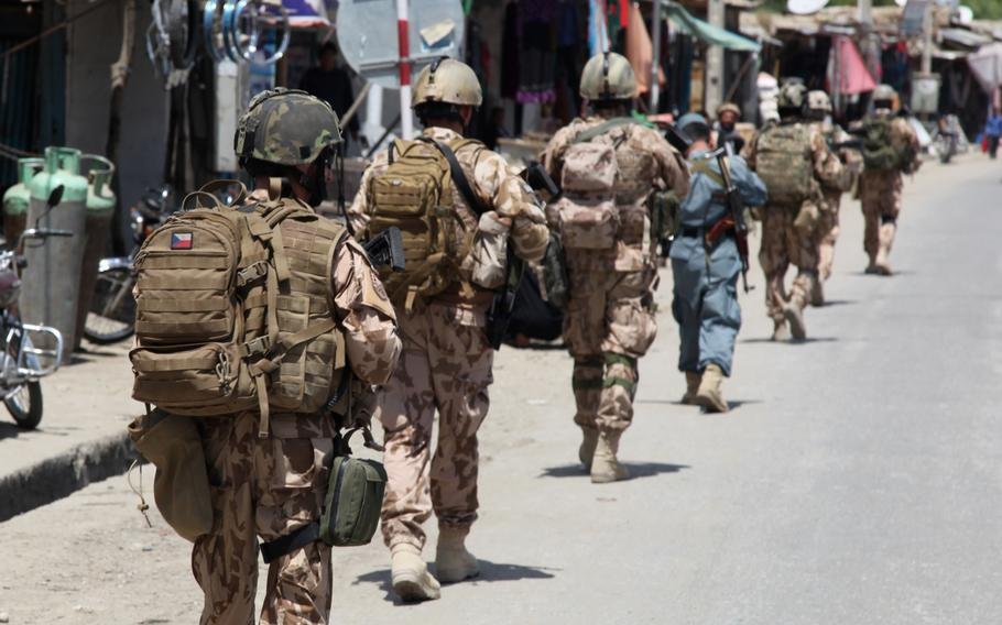 Czech soldiers patrol through Dihi Babi village, Parwan province, Afghanistan, April 29, 2014. The Czech Defense Ministry has confirmed that the NATO servicemember killed in Herat yesterday was Czech.