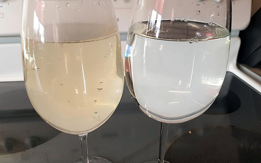 Hot and cold tap water in a photo taken on March 7, 2018, at a unit at Wenzel Housing, Baumholder. According to a resident, the brown color showed up after the pipes were treated to kill Legionella bacteria.
