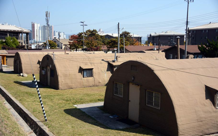 A row of Quonset huts at Camp Red Cloud, South Korea, with a view of the surrounding city of Uijeongbu is seen Sunday, Oct. 21, 2018.