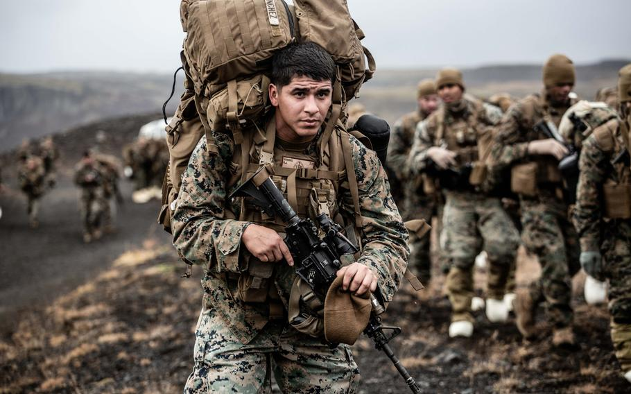 A U.S. Marine carries cold weather equipment as he begins to march across the Icelandic terrain Oct. 19, 2018. Marines with the 24th Marine Expeditionary Unit are in Iceland preparing for NATO's Trident Juncture 2018.