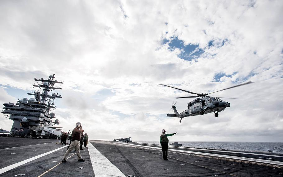 An MH-60S Seahawk takes off from the flight deck of the aircraft carrier USS Ronald Reagan in waters south of Japan in 2015.