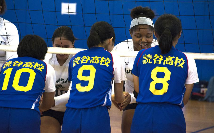 High school volleyball players from the U.S. and Japan greet one another after a match at Kadena Air Base, Okinawa, Saturday, Oct. 20, 2018.