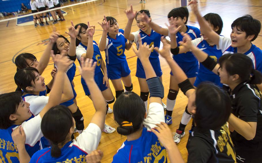 Volleyball players from a high school on Okinawa cheer before a match at Kadena Air Base, Okinawa, Saturday, Oct. 20, 2018.