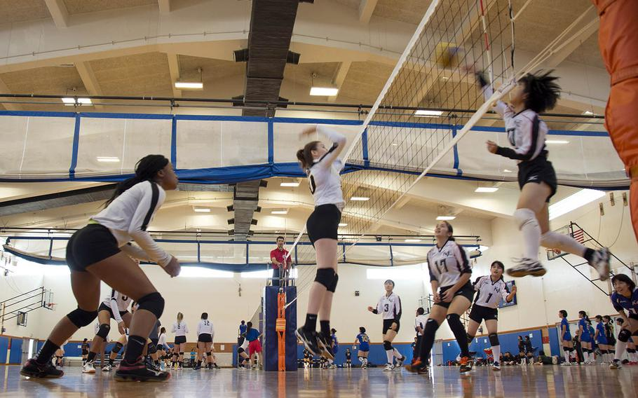 Volleyball players from Japanese and Department of Defense Education Activity high schools compete at Kadena Air Base, Okinawa, Saturday, Oct. 20, 2018.