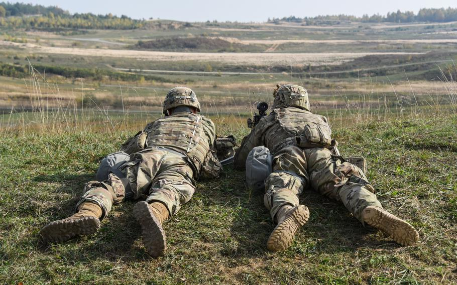 U.S. soldiers assigned to 2nd Cavalry Regiment scan the range during a live-fire exercise as part of Dragoon Ready at the 7th Army Training Command's Grafenwoehr training area, Germany, Oct. 17, 2018.