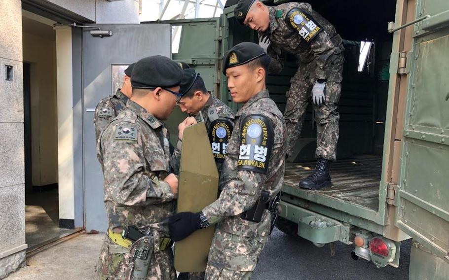 The U.S.-led United Nations Command and the two Koreas complete removal of firearms and guard posts from truce village of Panmunjom.