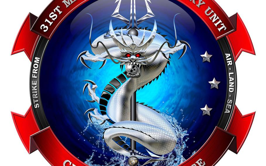 The Okinawa-based 31st Marine Expeditionary Unit's  new insignia features a fearsome East Asian sea dragon bursting from the ocean while wrapped around a trident.