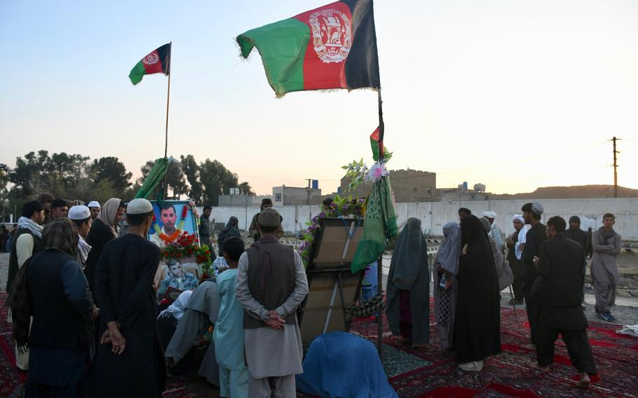 Mourners visit the grave of former Kandahar police chief Gen. Abdul Raziq on Thursday, Oct. 25, 2018, one week after Raziq was assassinated in an attack claimed by the Taliban.