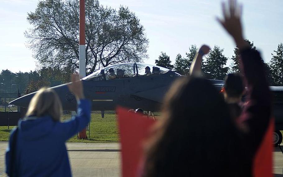 Family members greet F-15E Strike Eagle pilots from the 494th Fighter Squadron as they return from a six-month combat deployment fighting the Islamic State to RAF Lakenheath, England, Sunday, Oct. 7, 2018. The last contingent of airmen returned last week, service officials said.