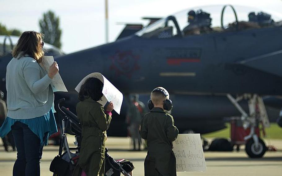 Family members patiently await an F-15E Strike Eagle pilot  returning home from a six-month combat deployment against the Islamic State to RAF Lakenheath, England, Sunday, Oct. 7, 2018. The 494th Fighter Squadron flew 2,000 sorties in about 11,000 flight hours and dropped more than 500 precision-guided munitions in support of U.S. Central Command operations.