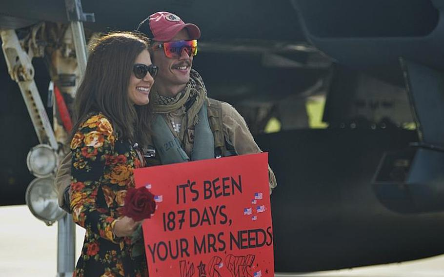 An F-15E Strike Eagle pilot reunites with his wife after returning home from a combat deployment to RAF Lakenheath, England, Sunday, Oct. 7, 2018. The 494th Fighter Squadron flew 2,000 sorties in about 11,000 flight hours and dropped more than 500 precision-guided munitions during the six-month deployment in South East Asia.