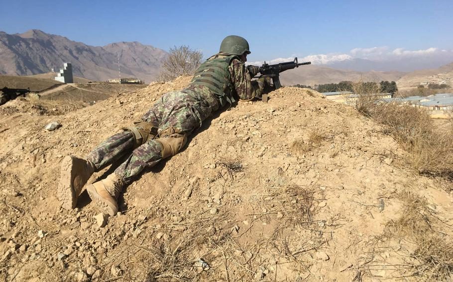 An Afghan soldier takes part in commando training in Kabul on Nov. 26, 2017. Plans are underway to double the country's commando force in a bid to reverse recent gains by Taliban insurgents.