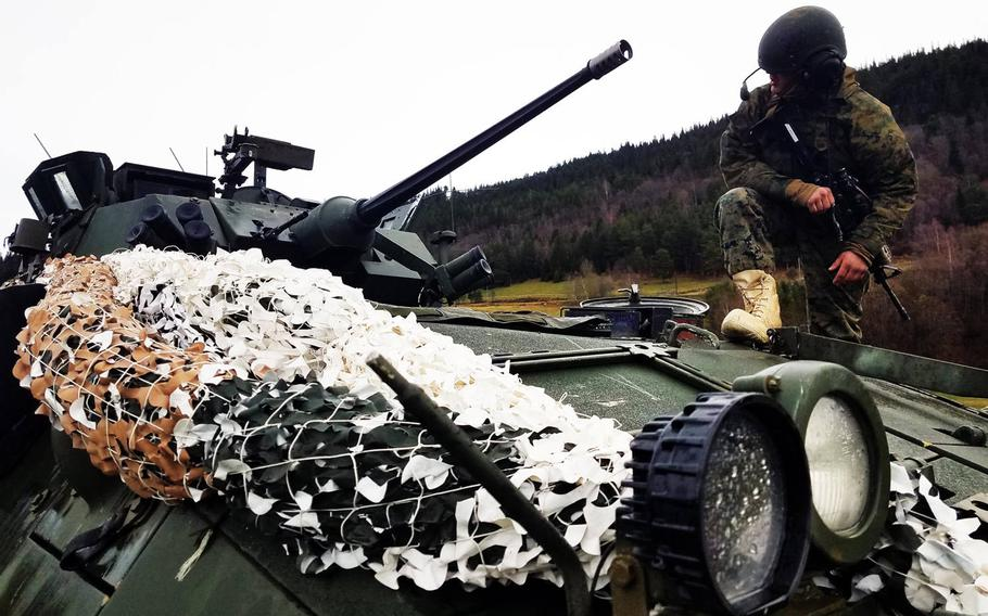 Lance Cpl. Blake Bailey stands atop an LAV-25, at Exercise Trident Juncture, near Rennebu, Norway, Wednesday, Oct. 31, 2018.