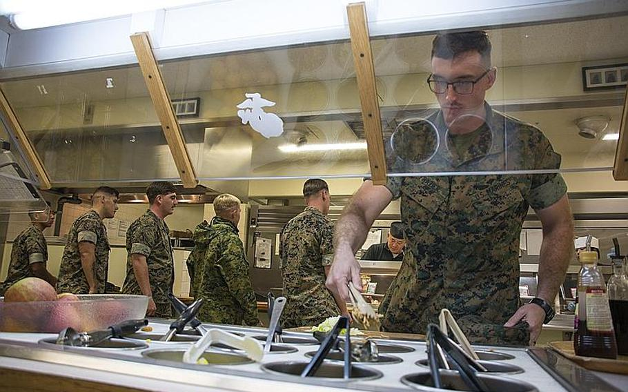 A Marine grabs a meal at the 12th Marines Mess Hall at Camp Hansen, Okinawa, Oct. 12, 2018.