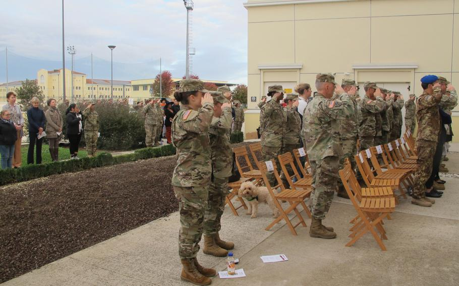 Soldiers salute during a ceremony to open the new Vicenza Veterinary Treatment Facility at the Vicenza Health Center. Only one dog, and no cats, attended.