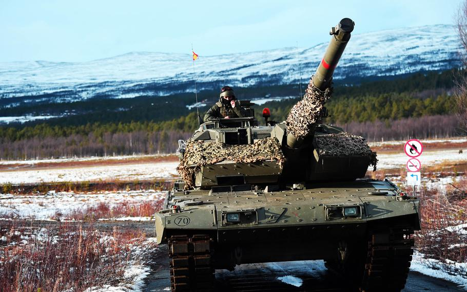 A Spanish Leopard 2E tank defends the airfield during the simulated Battle of Oppdal, part of Exercise Trident Juncture, in Oppdal, Norway, Thursday, Nov. 1, 2018.