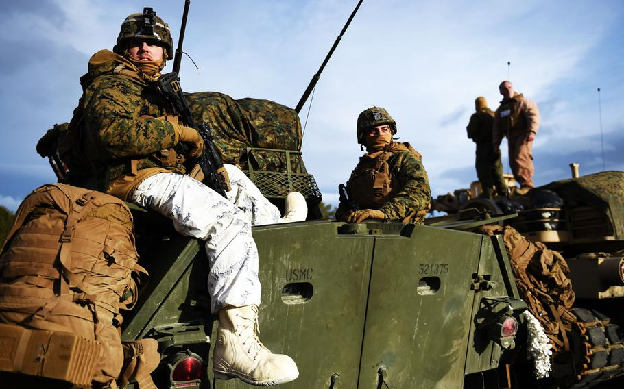 Marines in cold weather gear, on top an LAV-25, prepare during the simulated Battle of Oppdal, part of Exercise Trident Juncture, in Oppdal, Norway, Thursday, Nov. 1, 2018.