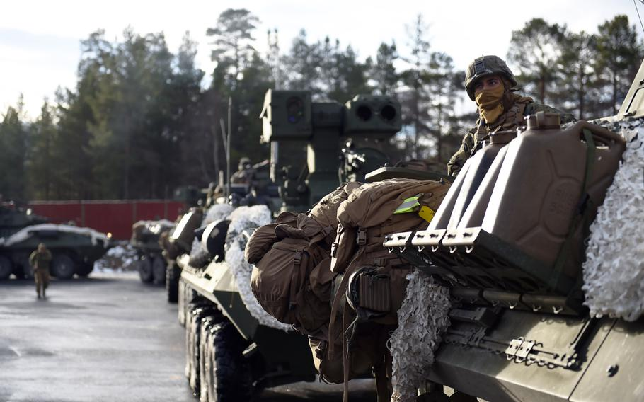 A row of Marine LAV-25s stage before the main attack during the Battle of Oppdal, part of Exercise Trident Juncture, in Oppdal, Norway, Thursday, Nov. 1, 2018.