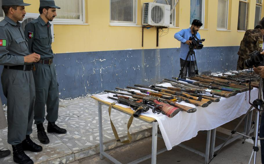 Police officials display 129 weapons they say they seized from militants fighting the government in Herat province in western Afghanistan on June 4, 2018. Infighting between Taliban factions had led to 40 deaths recently, Herat officials said Nov. 2, 2018.