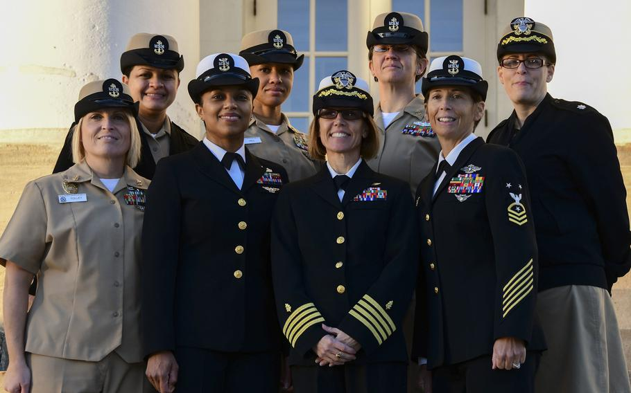 Naval Medical Center Portsmouth officers and chief petty officers gather for a group photo wearing their combination, or ''bucket,'' covers. The last day female officers and chief petty officers could wear the bucket was Oct. 31, 2018.